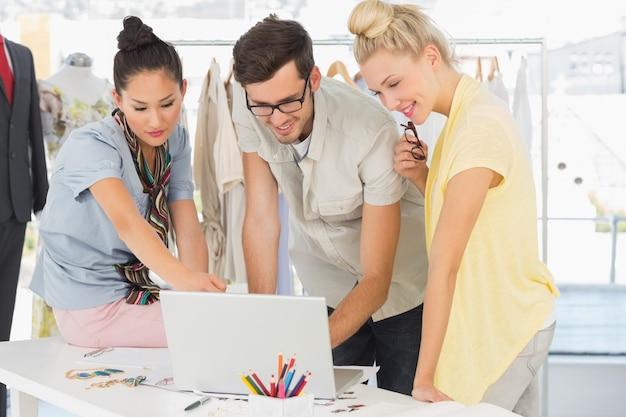Fashion designers using laptop