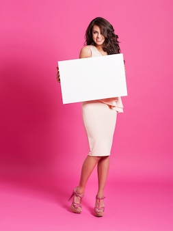 Fashion and elegant woman holding whiteboard