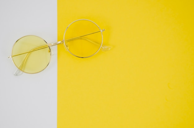 Fashion eyeglasses on colorful background