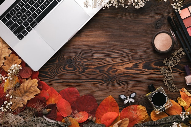 Fashion female accessories set. autumn leaves and laptop