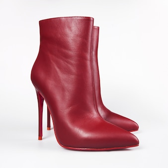 Fashion female boots on white surface
