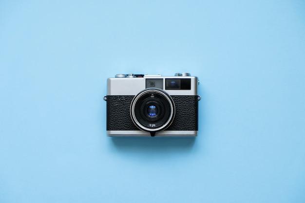 Fashion film camera on blue. retro vintage accessories