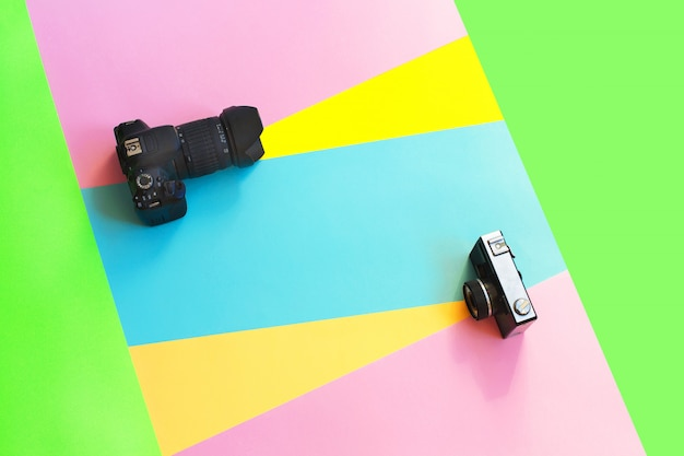 Fashion film and digital camera on colored creative.