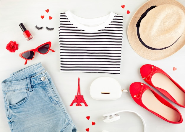 Fashion flat lay with french style girls urban outfit with t-shirt, ballerina shoes , sunglasses and jeans.