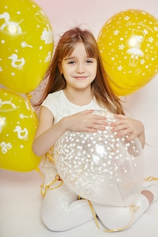Fashion girl child celebration with balloons