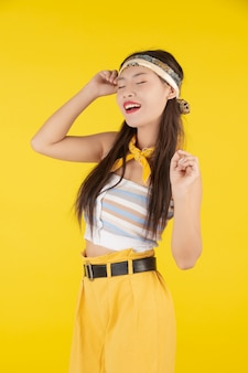 Fashion girl dress up with a hand gesture