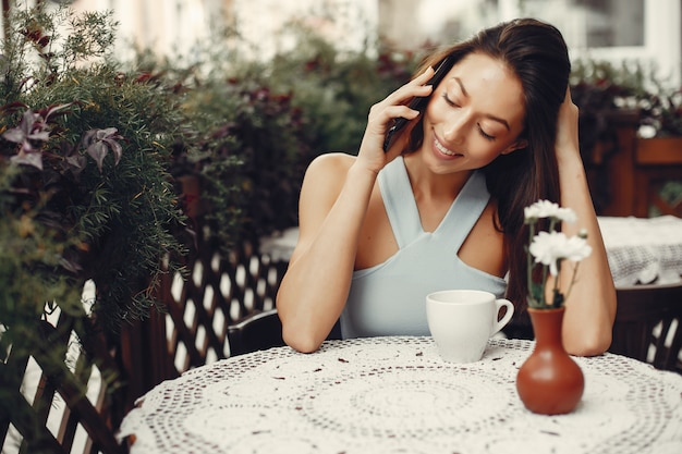 Fashion girl drinking a coffee in a cafe