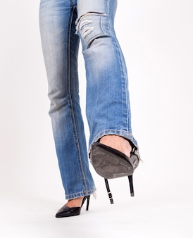 Fashion girl in high heel shoes and denim jeans