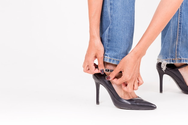 Fashion girl in high heel shoes and denim jeans.