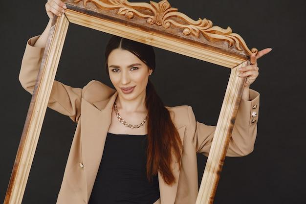 Fashion girl posing in a photo studio