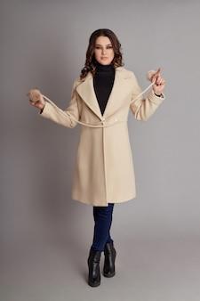Fashion girl in spring coat, autumn wear