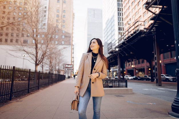Fashion girl walking in a sping city