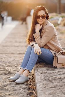 Fashion girl walking in a sspring park