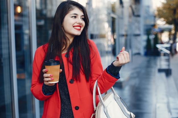 Fashion girl walking in a summer city