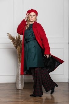 Fashion and glamour concept - stylish woman in a beret and coat on a light background. coat, beret, clothes, style, fashion, beauty, young woman