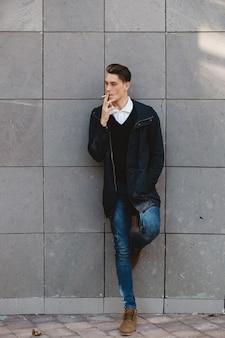 Fashion hipster male model smoking