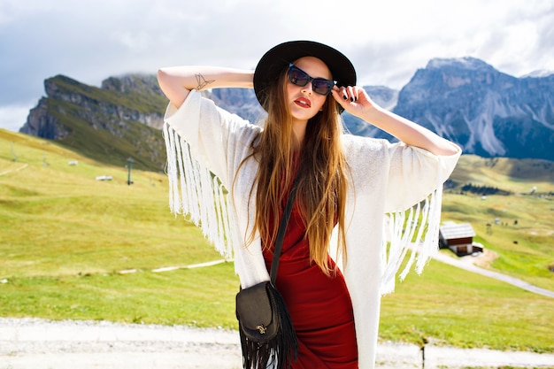 Fashion image of stylish woman wearing elegant luxury boho style outfit