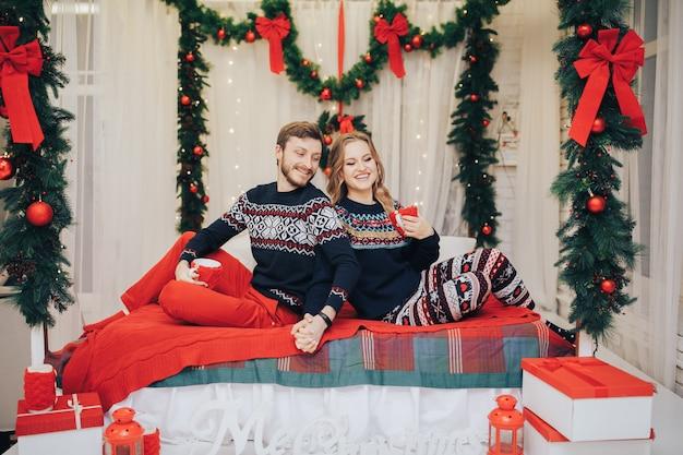Fashion interior holiday christmas photo of beautiful tender couple