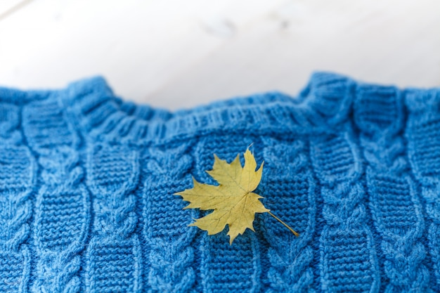 Fashion knitted handmade pullover (sweater) for the baby (boy or girl) with balls of wool and knitting needles