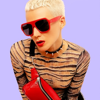 Fashion lady swag luxury style. stylish accessories. clutch and sunglasses blonde short hair