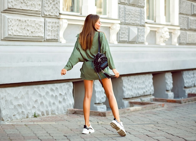 Fashion lifestyle image of fashionable hipster woman posing on the street