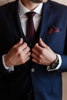 Fashion man in classical suit costume and tie. modern businessman