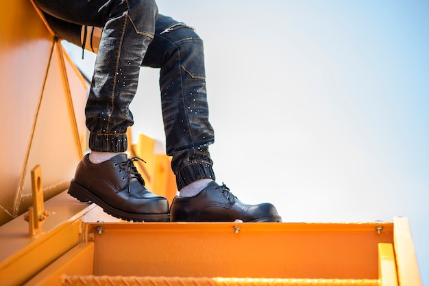 Fashion man wearing jeans and black shoes