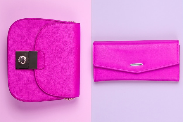 Fashion minimalistic concept. two bags, purse on pastel background. top view