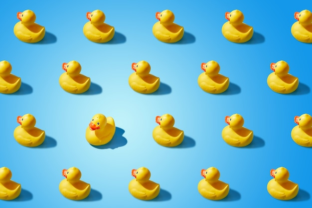 Fashion minimalistic concept of a yellow rubber duck pattern flat lay. not like everyone else, goes against the system.