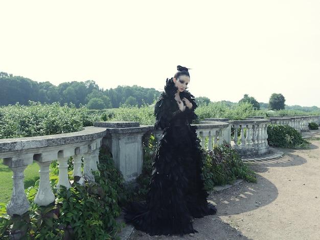 Fashion model in black dress