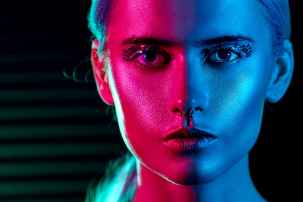Fashion model blonde woman in colorful bright neon lights posing