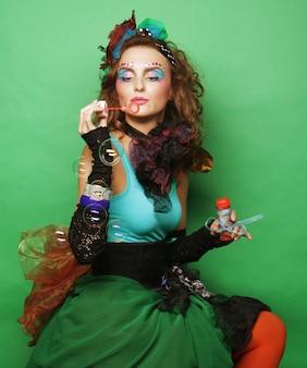Fashion model  blowing soap bubbles ,