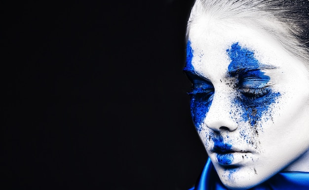 Fashion model girl portrait with colorful powder make up.