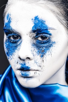 Fashion model girl portrait with colorful powder make up