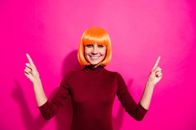 Fashion model posing with orange wig
