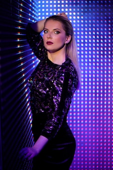 Fashion model woman in colorful bright neon uv blue and purple lights, beautiful girl