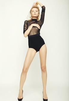 Fashion model woman with perfect slim body
