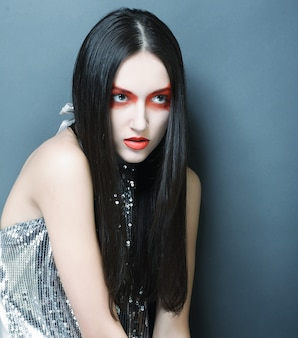 Fashion model woman with red make up