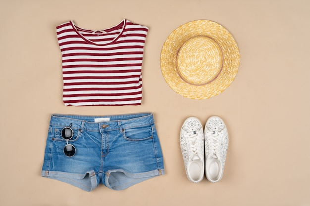 Fashion outfit for a woman on a beige  top view