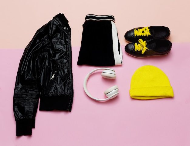 Fashion outfit for women stylish black clothes and bright accessories sports urban minimal headphone