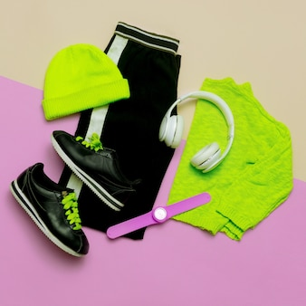 Fashion outfit for women stylish clothes and bright accessories sports urban minimal top view headph