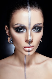Fashion perfect makeup, silver color band on the girl face, silver eyebrows