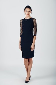 Fashion photo of young magnificent woman in a black dress