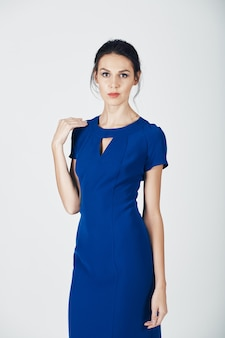 Fashion photo of young magnificent woman in a blue dress