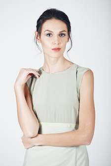 Fashion photo of young magnificent woman in a bright dress