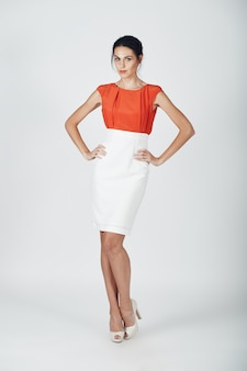 Fashion photo of young magnificent woman in a white
