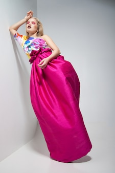 Fashion photo of young woman in pink dress