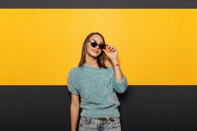 Fashion portrait of an appealing, stylish woman with sunglasses