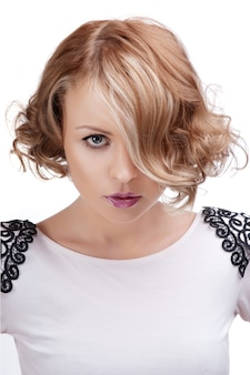 Fashion portrait of a beautiful blonde woman with red lips.