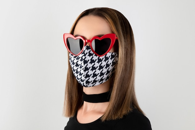 Fashion portrait of beautiful woman in fashionable protective mask